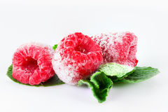 Frozen raspberries with mint leaves on white. Frozen raspberries macro with mint leaves and ice  on white background Stock Photos