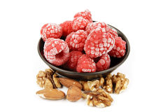 Frozen Raspberries and Nuts Royalty Free Stock Photos