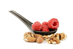 Frozen Raspberries On A Spoon With Nuts
