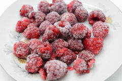Frozen raspberries on a saucer Royalty Free Stock Photo