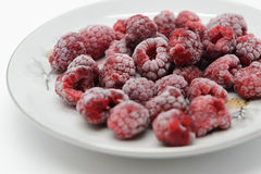 Frozen raspberries on a saucer Stock Photography