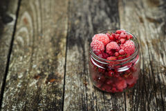 Frozen raspberries. Selective focus. Space for text. Stock Photos