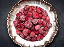 Frozen raspberries Stock Images