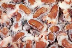 Frozen raw chicken hearts. Chicken offal.  Closeup of frozen raw chicken hearts Royalty Free Stock Photos
