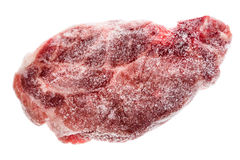 Frozen raw pork neck chops meat steak isolated on white. Frozen uncooked slices of beef steaks, tenderloin or rib eye with ice crystals on it Stock Photography