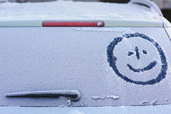 Frozen rear window. Drawing on the rear window of a car made by hand Royalty Free Stock Image