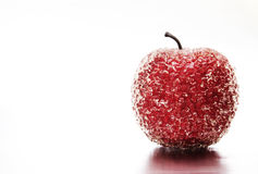 Frozen red apple. Frozen plastic red apple with reflection Royalty Free Stock Photo