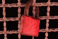 Frozen red love lock on the bridge Stock Photo