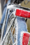 Frozen red reflector on a bike. Frozen red reflector by fog on a blue bicycle royalty free stock image