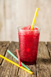 Frozen Red Slushie in Plastic Cup with Straw Royalty Free Stock Images