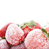 Frozen red strawberries. copy space. white background Royalty Free Stock Images