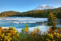 Frozen Reflection Lake and  Mount Rainier at Mount Rainier National Park. Washington State, USA stock photos