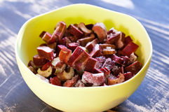 Frozen rhubarb. Pieces of frozen rhubarb thawing in a bowl Stock Photography
