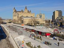 Frozen rideau canal with skaters and Fairmont Château Laurier castle on a sunny winter day. With blue sky in Ottawa, Canada stock photos