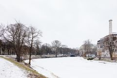 A Frozen Riga Canal in Bastion Hill Park. A winter view along a frozen Riga canal.  The canal flows through Bastion Hill park in Riga, Latvia Stock Photos