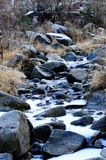 Frozen river. With boulders in wintertime Royalty Free Stock Image