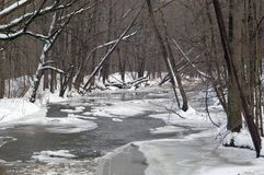 Frozen River. A river partially covered with ice after a heavy snow storm Stock Photos