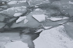 Frozen river with accumulated drift ice putting preasure on dock Royalty Free Stock Image