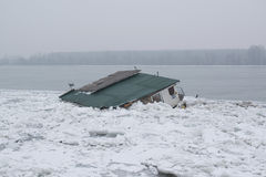 Frozen river with accumulated drift ice putting preasure on dock Royalty Free Stock Images