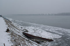 Frozen river with accumulated drift ice putting preasure on dock Royalty Free Stock Photos