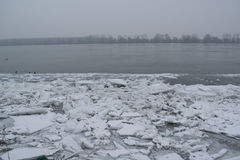 Frozen river with accumulated drift ice putting preasure on dock Royalty Free Stock Photo