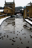 A Frozen River Aire, Skipton. The River Aire is a major river in Yorkshire, England, 71 miles (114 km) in length. Part of the river is canalised, and is known as Stock Photos