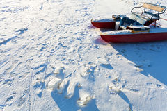 Frozen river boat in cold winter day Stock Photos
