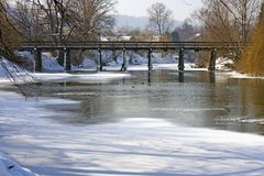 Frozen river with bridge Royalty Free Stock Photos