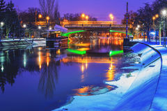 Frozen river and a bridge at night Stock Photography