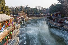 Frozen river through a chinese village stock images