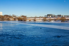 Frozen river in city limits Royalty Free Stock Photo