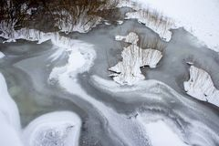 Frozen river covered with snow in winter. stock photography