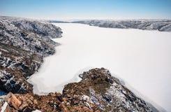 Frozen river in the desert Stock Images