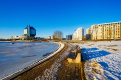 Frozen river  flowing near national library in residential area royalty free stock images