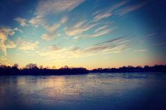Frozen River. Frozen and icy river at sunset Royalty Free Stock Photo