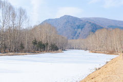 Frozen river and mountain in northern China Royalty Free Stock Images