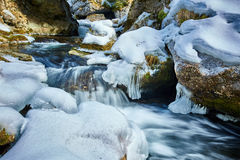 Frozen river on mountains Stock Photography