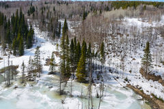 Frozen river in the mountains of the Salair ridge Royalty Free Stock Photo
