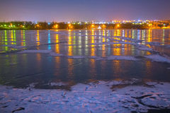 Frozen river nad night city Royalty Free Stock Photography