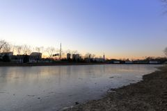 Frozen river near beijing olympic park at sunrise in winter, adobe rgb Royalty Free Stock Photography