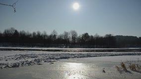 Frozen river neris in winter sunlight and floating floe in water stock video