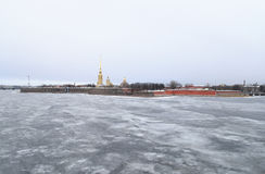 Frozen River Neva and bastion of Peter and Paul Fortress. Stock Image
