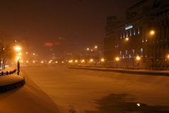 Frozen river by night. Frozen river in the city night lights Royalty Free Stock Images