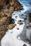 Frozen river with rocks Royalty Free Stock Photos