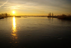 Frozen river at sunrise. In Holland stock photos