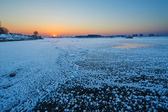 The frozen river sunrise Stock Photos