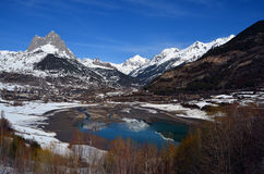 Frozen river in the valley. With the pyrenees behind Royalty Free Stock Image