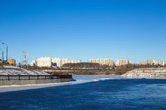 Frozen river and the waterfront on a Sunny day Royalty Free Stock Image