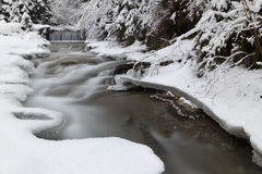 Frozen River on a winter day in the mountains. Frozen River , ice and snow, on a winter day in the mountains stock image