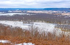Frozen River in Winter from its Bluffs royalty free stock image